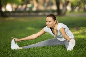 fitness girl expert active recovery in park